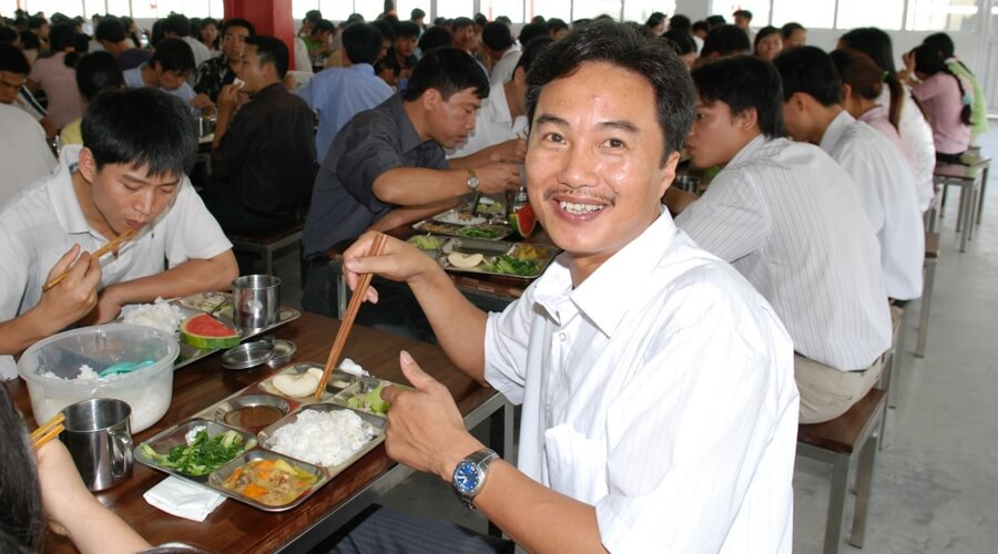 People-eating-lunch-smiling  | Own factories in Vietnam: